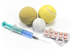Теннис и шар для игры в гольф с шприцем и пилюльками Стоковое Изображение RF
