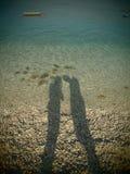 Тень женщины и человека Стоковое Изображение