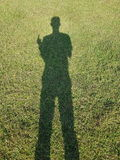 Тень людей принятых на солнечный день Стоковые Фото