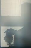 Тень от фотографа на бетонной стене светлое окно Стоковое Изображение