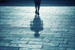 Тень человека идет с предпосылкой двоичных чисел Стоковая Фотография RF