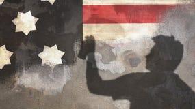 Тень человека и картина граффити флага США Стоковое Изображение RF