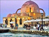 Теплый вечер в Chania, Крит, Греция иллюстрация штока
