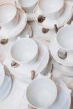 Теплая чашка чаю с помадками и конфетами Стоковая Фотография