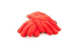 Теплые перчатки, красные перчатки шерстей на белой предпосылке Стоковое Фото