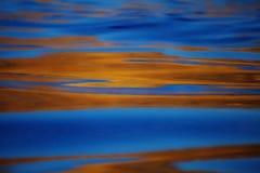 Теплый конспект захода солнца океана зарева Стоковое фото RF