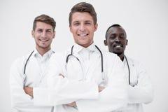 Терапевт стоит перед его коллегами стоковое изображение rf