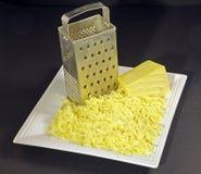 терка заскрежетанная сыром стоковая фотография rf