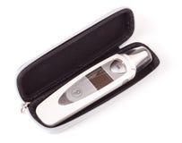 Термометр уха в коробке на белой предпосылке Стоковое Изображение