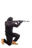 Террорист с оружием на белизне Стоковое Фото