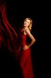 тесемка красного цвета девушки платья Стоковая Фотография RF