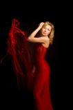 тесемка красного цвета девушки платья Стоковое Фото