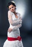 тесемка красного цвета модели невесты смычка Стоковое Фото