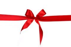 тесемка красного цвета подарка смычка Стоковое Изображение RF