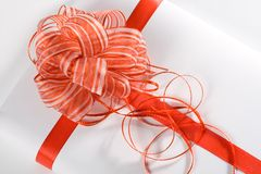 тесемка красного цвета подарка Стоковая Фотография