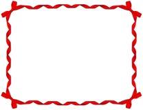 тесемка красного цвета рамки смычка Стоковые Изображения