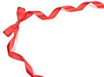 тесемка красного цвета рамки смычка Стоковая Фотография