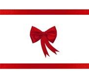 тесемка красного цвета рождества смычка Стоковые Изображения RF