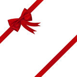 тесемка красного цвета рождества смычка Стоковое фото RF