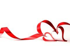 тесемка красного цвета сердца смычка Стоковое фото RF