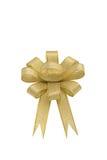 тесемка смычка золотистая изолированная Стоковое Изображение