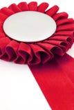тесемки красного цвета значка пожалования Стоковые Фотографии RF