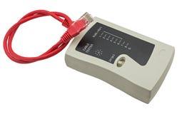 Тестер кабеля сети с кабелем UTP на белой предпосылке Стоковая Фотография