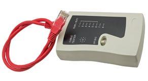Тестер кабеля сети с кабелем UTP на белой предпосылке Стоковая Фотография RF