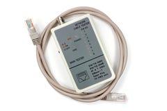 Тестер кабеля сети с кабелем UTP на белой предпосылке Стоковые Фотографии RF