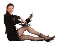 тетрадь девушки пола сидит работы Стоковое Изображение RF