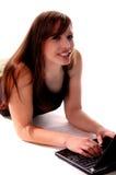 тетрадь девушки 3 компьютеров Стоковое фото RF