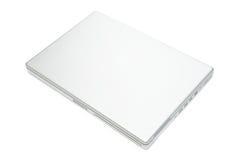 тетрадь изолированная компьютером Стоковое фото RF
