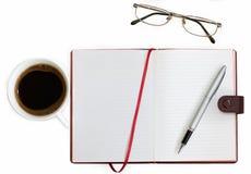 тетрадь стекел кофейной чашки Стоковая Фотография