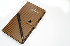Тетрадь с ручкой Стоковое Изображение RF