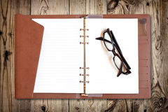 тетрадь eyeglasses Стоковые Изображения RF