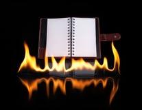 Тетрадь в пламени пожара Стоковая Фотография RF
