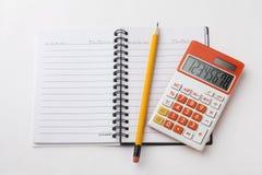 тетрадь и карандаш калькулятора Стоковая Фотография