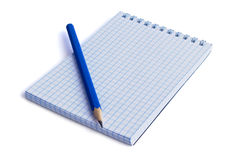 Тетрадь и карандаш стоковые фото