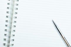 Тетрадь и ручка Стоковые Фото