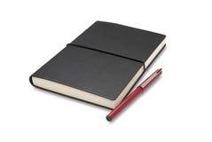 Тетрадь и ручка Стоковые Фотографии RF