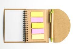 Тетрадь и postit и ручка Стоковые Изображения RF