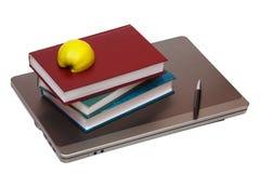 Тетрадь, книги и половина яблока Стоковые Изображения RF