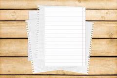 Тетрадь на деревянной таблице для текста и предпосылки Стоковые Фото