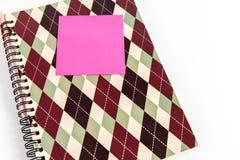 Тетрадь, ручка и вывешивает ее Стоковая Фотография RF