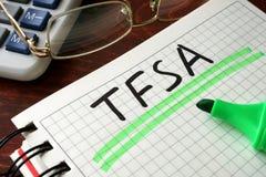 Тетрадь с знаком TFSA на таблице Стоковые Фото