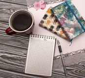 Тетрадь с кофе Стоковые Фото