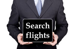 Технология, интернет и сеть в концепции туризма - бизнесмен держа ПК таблетки с полетами поиска подписывает Стоковая Фотография RF