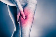Телесное повреждение, боль ноги икры Стоковая Фотография