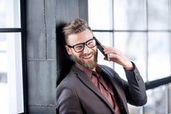 телефон бизнесмена франтовской Стоковое Изображение