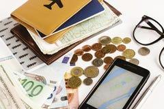 Телефон денег пасспорта с картой и стекла на белой предпосылке, Стоковые Фотографии RF